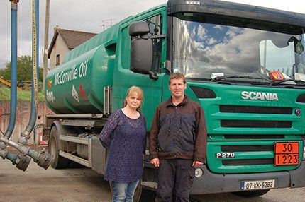 Celebrating 20 years in business, Jerry Cosgrave and Leon Byrne  beside McConville Oil's tanker