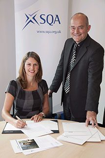 Brian Worrall, DODF chair and Marisa Ferguson, contracts manager, SQA, at the signing of the PDP agreement