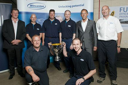 Barnaby (kneeling on left) with Wincanton's Driver of the Year category winners