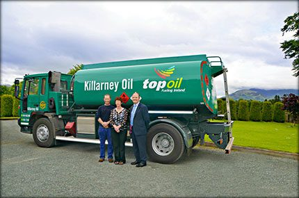 Brother and sister James and Asumpta O'Donoghue of Killarney Oil with John O'Donovan, national reseller manager, Top Oil