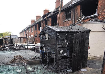 The Northern Ireland Fire and Rescue Service is still investigating the cause of the oil tank fire which caused extensive damage to three houses Pic Colm Lenaghan/Pacemaker