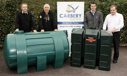 (l-r) Jim Hunt and Kevin Kelleher who were involved in the production of Carbery Plastics's first tank  - a 1550L  - 30 years ago, with Cal and Michael McCarthy beside the 650L Combi R – Carbery's newest design