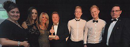 Members of the Tuffa team celebrate their award winning success