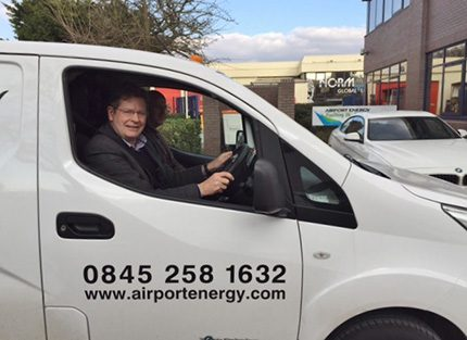 Phil Wright, former  chairman of the Airport Energy Group, who retired last year, takes a spin in the new 100% electric powered van