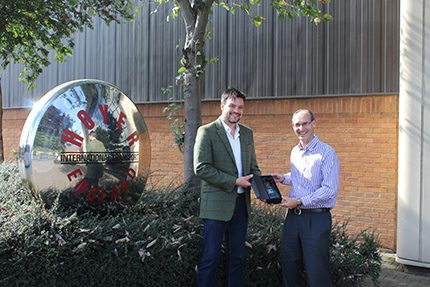 Mark Binns (r) receives the award from Chris Lee, managing director of Lucas Lee & Partners